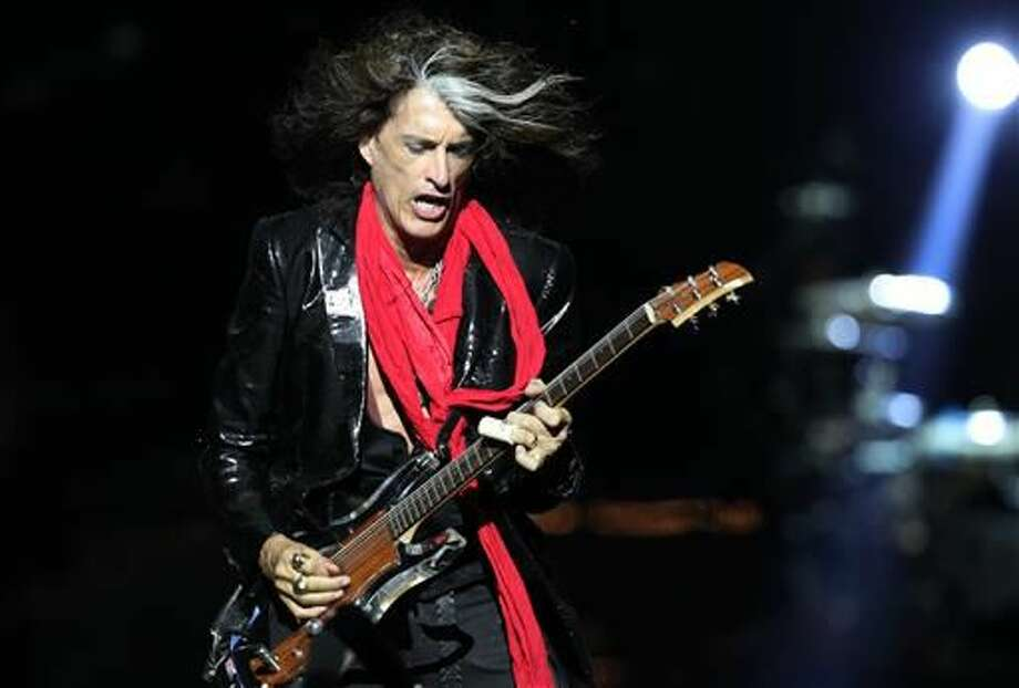 Lead guitarist Joe Perry was taken to a hospital after he was forced to leave the stage while performing in New York City with Johnny Depp and Alice Cooper in his side band, the Hollywood Vampires. Photo: Wong Maye-E | AP File Photo