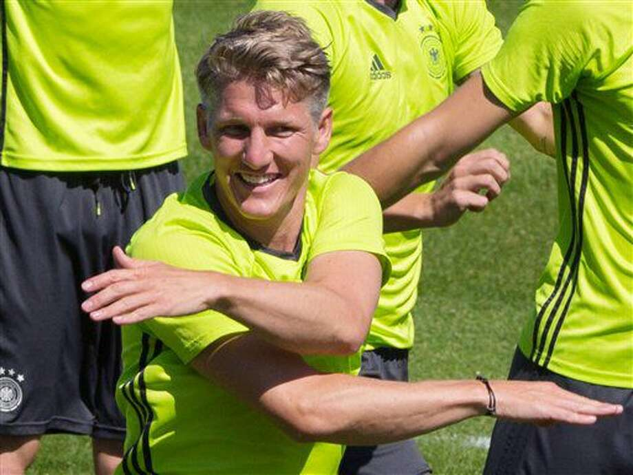 Bastian Schweinsteiger, center, attends the last training session of the German national football team at their base camp in Evian-Les-Bains, France, Wednesday, July 6, 2016. Germany will face France in a Euro 2016 semifinal soccer match in Marseille on Thursday, July 7, 2016 (AP Photo/Cirian Fahey) Photo: Cirian Fahey