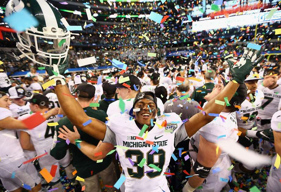 ARLINGTON, TX - JANUARY 01:  Jermaine Edmondson #39 of the Michigan State Spartans celebrates a 42-41 win against the Baylor Bears during the Goodyear Cotton Bowl Classic at AT&T Stadium on January 1, 2015 in Arlington, Texas.  (Photo by Ronald Martinez/Getty Images) Photo: Ronald Martinez, Getty Images