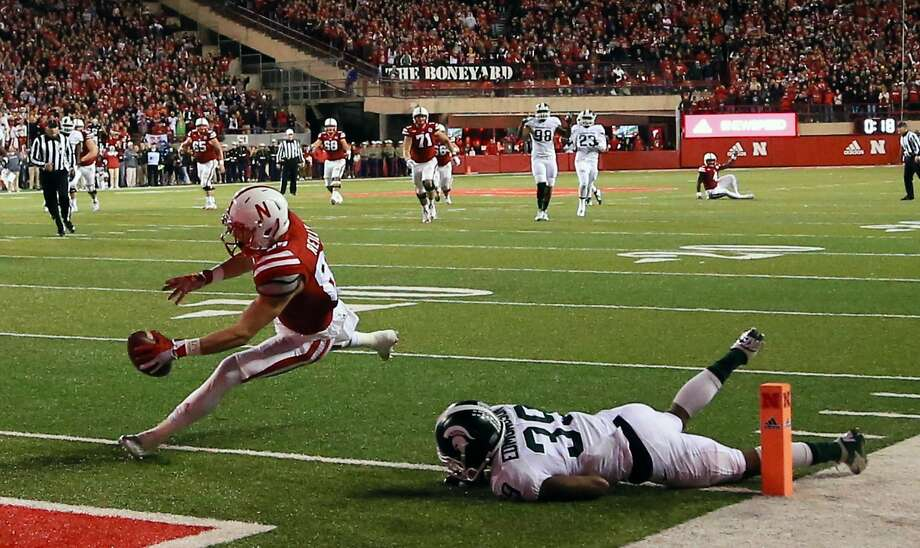 Nebraska wide receiver Brandon Reilly (87) scores a touchdown against Michigan State cornerback Jermaine Edmondson (39) during the second half of an NCAA college football game in Lincoln, Neb., Saturday, Nov. 7, 2015. Nebraska won 39-38. (AP Photo/Nati Harnik) Photo: Nati Harnik, Associated Press