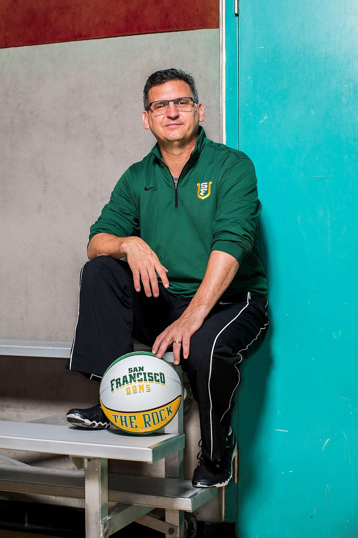 USF men's basketball coach Kyle Smith poses for a portrait after an informal workout at Swig Gym inside Koret Health and Recreation Center in San Francisco, Calif. on Tuesday, July 12, 2016.