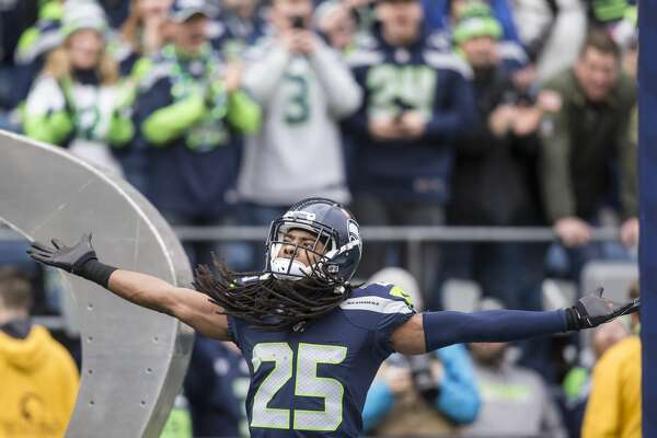 SEATTLE, WA - DECEMBER 20: Cornerback Richard Sherman #25 of the Seattle Seahawks gestures during player introductions before a football game against the Cleveland Browns at CenturyLink Field on December 20, 2015 in Seattle, Washington. The Seahawks won the game 30-13. (Photo by Stephen Brashear/Getty Images)