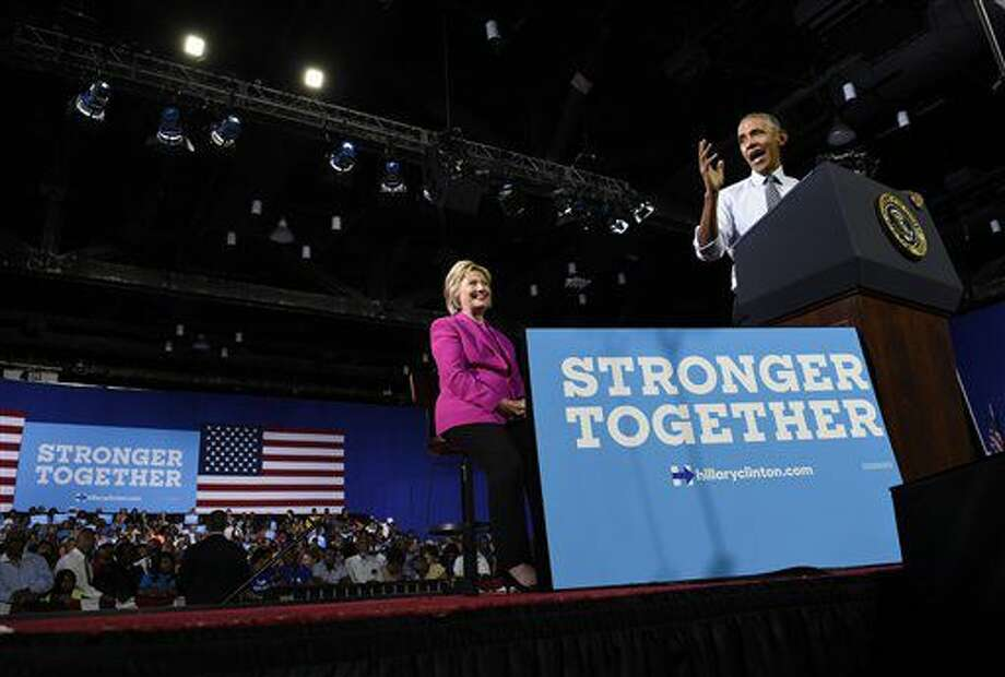 El presidente Barack Obama habla en un acto de campaña con la virtual candidata presidencial Hillary Clinton en Charlotte, North Carolina, el martes 5 de julio de 2016. (AP Foto/Susan Walsh) Photo: Susan Walsh