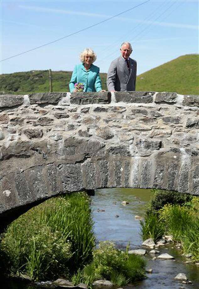 Prince Charles The Prince of Wales and the Duchess of Cornwall look out from a bridge in the village of Aberdaron, northern Wales, on the second day of their annual summer visit to Wales, Tuesday July 5, 2016. Wales soccer team face-off against Portugal on upcoming Wednesday during the Euro 2016 semi-final. (Chris Jackson / PA via AP) Photo: Chris Jackson