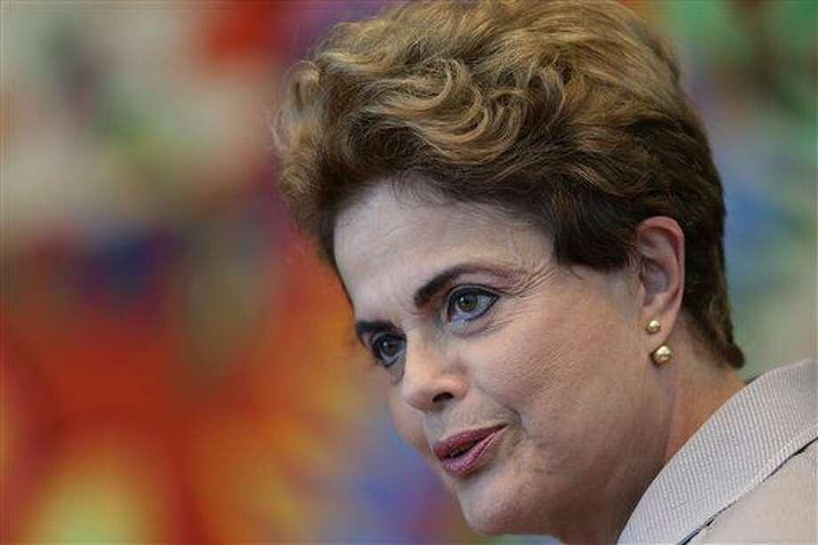 La presidenta suspendida de Brasil, Dilma Rousseff, habla durante una conferencia de prensa el 14 de junio de 2016 en el palacio presidencial de la Alvorada, en Brasilia. (AP Foto/Eraldo Peres, Archivo) Photo: Eraldo Peres