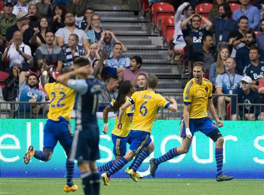 Colorado Rapids' Axel Sjoberg, right, celebrates with teammates Micheal Azira (22), Sam Cronin (6) and Marlon Hairston after scoring the tying goal against the Vancouver Whitecaps during the second half of an MLS soccer match Saturday, July 9, 2016, in Vancouver, British Columbia. (Darryl Dyck/The Canadian Press via AP) Photo: DARRYL DYCK