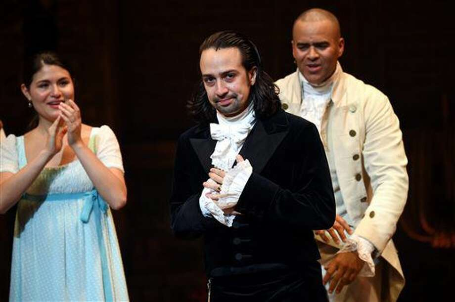 "Actor and ""Hamilton"" creator Lin-Manuel Miranda, center, takes his final performance curtain call at the Richard Rogers Theatre on Saturday, July 9, 2016, in New York. (Photo by Evan Agostini/Invision/AP) Photo: Evan Agostini"