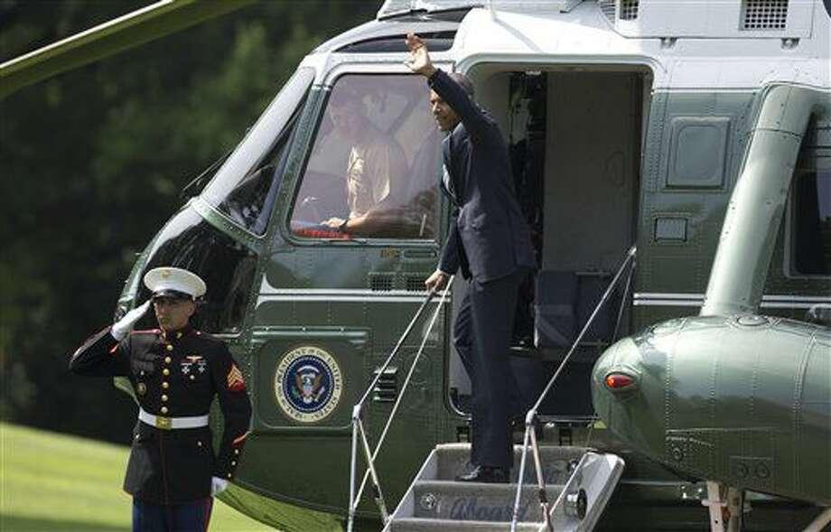 El presidente Barack Obama se monta en el helicóptero presidencial en la Casa Blanca en Washington rumbo a la Base Aérea Andrews, el 7 de julio del 2016, para iniciar una gira europea. (AP Foto/Carolyn Kaster) Photo: Carolyn Kaster