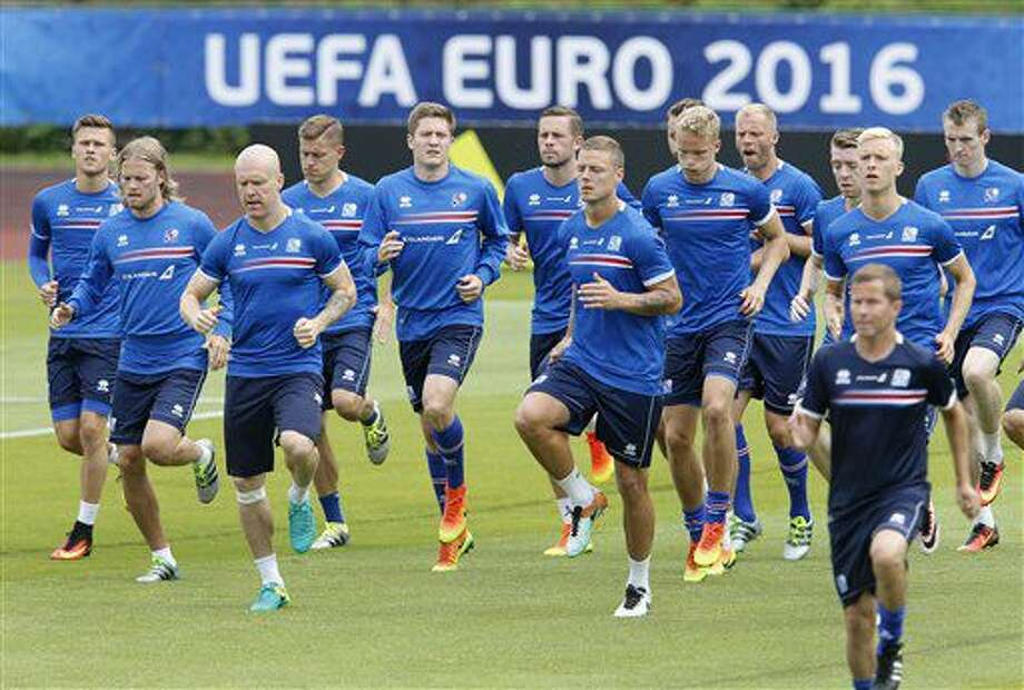Players attend a training session of Iceland's national soccer team at their base camp in Annecy, France, Thursday, June 30, 2016. Iceland will face France in a Euro 2016 quarterfinal match in Paris on Sunday, July 3, 2016.(AP Photo/Michael Probst) Photo: Michael Probst