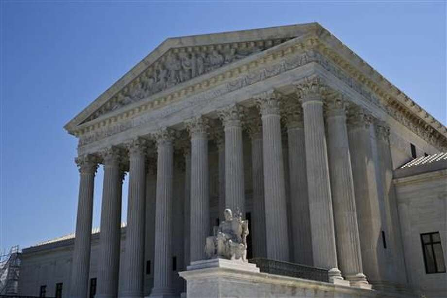 The Supreme Court is seen in Washington. The eight-justice court has eight cases to resolve in the waning days of a trying and mournful term since the death of Justice Antonin Scalia in February. (AP Photo/Alex Brandon)