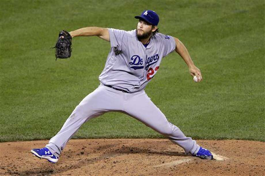FILE - In this June 26, 2016, file photo, Los Angeles Dodgers starting pitcher Clayton Kershaw delivers during the fifth inning of a baseball game against the Pittsburgh Pirates in Pittsburgh. After Kershaw had a follow-up examination on his sore back, the Dodgers said they remain unsure when the three-time NL Cy Young Award winner will return. (AP Photo/Gene J. Puskar, File) Photo: Gene J. Puskar