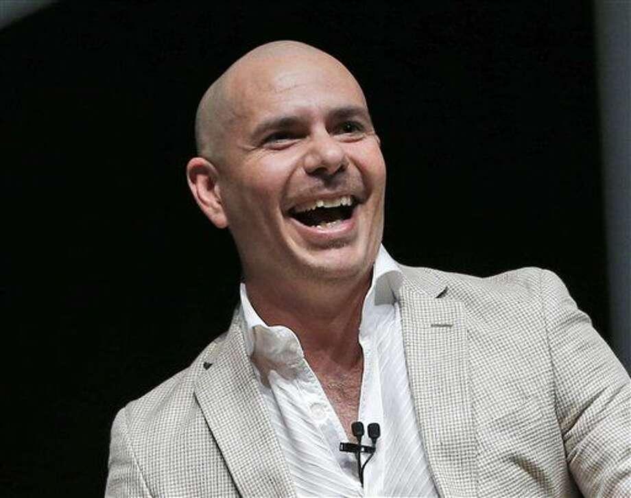 En esta foto del 19 de abril del 2016, Pitbull participa en el evento tecnológico eMerge Americas en Miami Beach, Florida. Pitbull develará su propia estrella en el Paseo de la Fama de Hollywood el 15 de julio del 2016. (AP Foto/Wilfredo Lee, Archivo) Photo: Wilfredo Lee