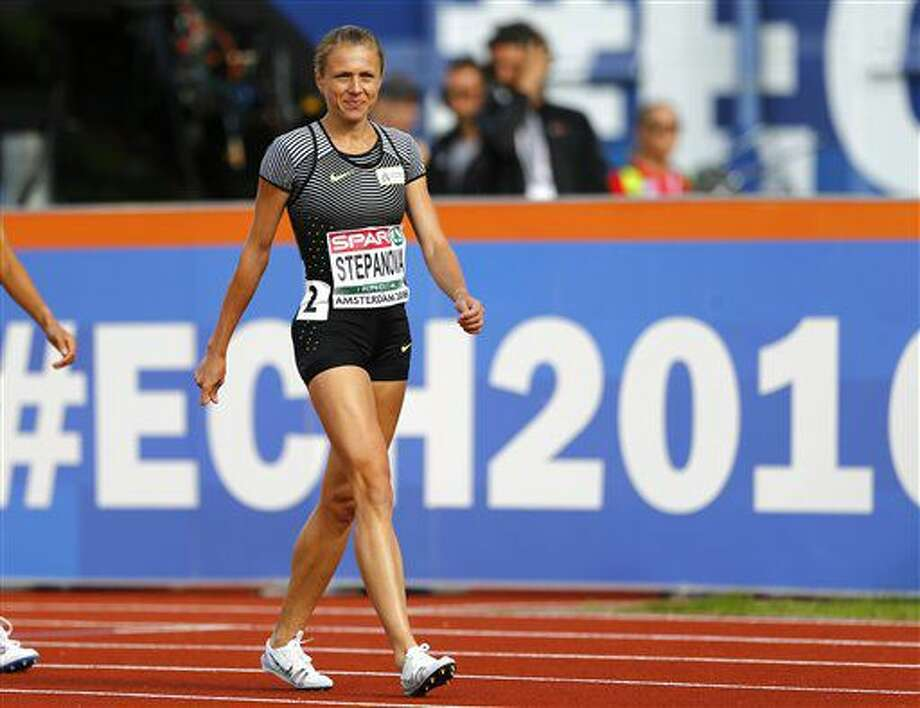 Russian doping whistleblower Yuliya Stepanova who runs under a neutral flag smiles as she arrive in the stadium to compete in a women's 800m heat during the European Athletics Championships in Amsterdam, the Netherlands, Wednesday, July 6, 2016. (AP Photo/Matthias Schrader) Photo: Matthias Schrader