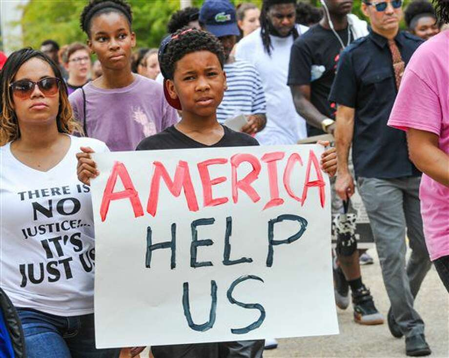 Protesters march to the state Capitol in Baton Rouge, La., Sunday, July 10, 2016. People are protesting the shooting death of a black man, Alton Sterling, by two white police officers at a convenience store parking lot last week. (Scott Clause/The Daily Advertiser via AP) Photo: Scott Clause