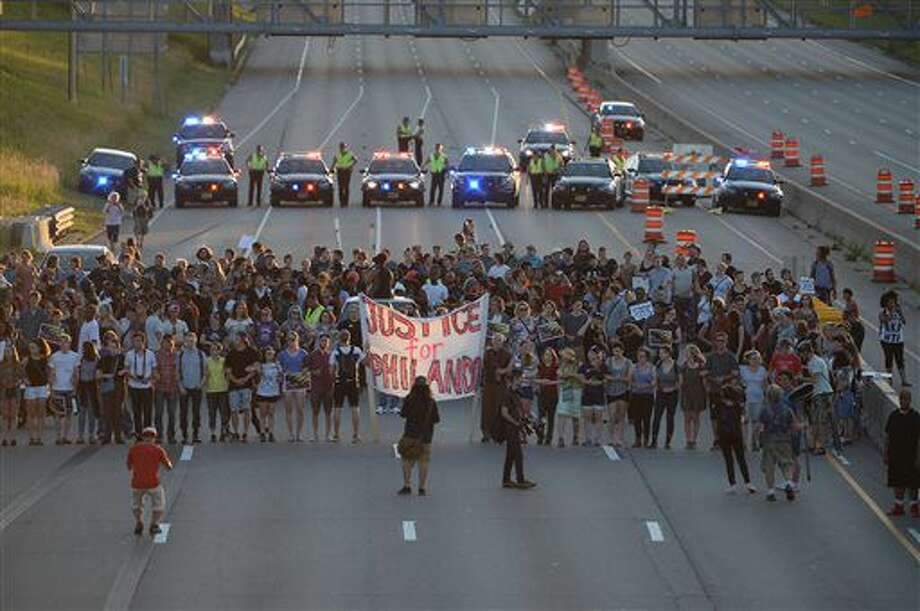 Marchers block part of Interstate 94 in St. Paul, Minn., Saturday, July 9, 2016, during a protest sparked by the recent police killings of black men in Minnesota and Louisiana. (Glen Stubbe/Star Tribune via AP) Photo: Glen Stubbe