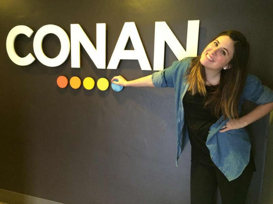 Annie Krueger is shown posing by the Conan sign while working as an intern on Conan O'Brian's show in the fall. Photo: Photo Provided