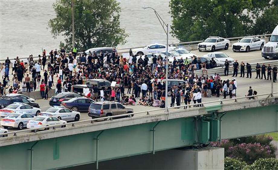 Black Lives Matter protesters gather on the Hernando Desoto Bridge in Memphis, Tenn., Sunday, July 10, 2016. Protesters angry over police killings of black people occupied the key bridge over the Mississippi River, blocking an interstate highway for hours. (Jim Weber/The Commercial Appeal via AP) Photo: Jim Weber