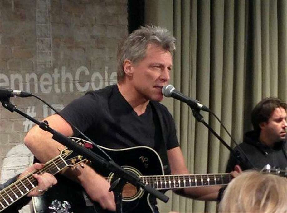 """FILE - In this Feb. 12, 2015, file photo, Jon Bon Jovi performs in New York as part an acoustic music series, Common Thread, an initiative created by the award-winning singer-songwriter, and fashion designer Kenneth Cole. Videos posted online in July 2016 show Bon Jovi taking the microphone to sing his band's 1986 classic """"Livin' on a Prayer."""" (AP Photo/John Carucci, File) Photo: John Carucci"""