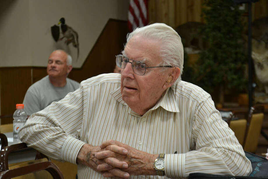 Dr. Howard Tanner, 92, considered the father of Great Lakes salmon, gives his opinion at the DNR's Lake Huron and Lake Michigan Joint Citizens Fishery Advisory Committee meeting Wednesday at Jay's Sporting Goods. Photo: Steve Griffin | For The Daily News