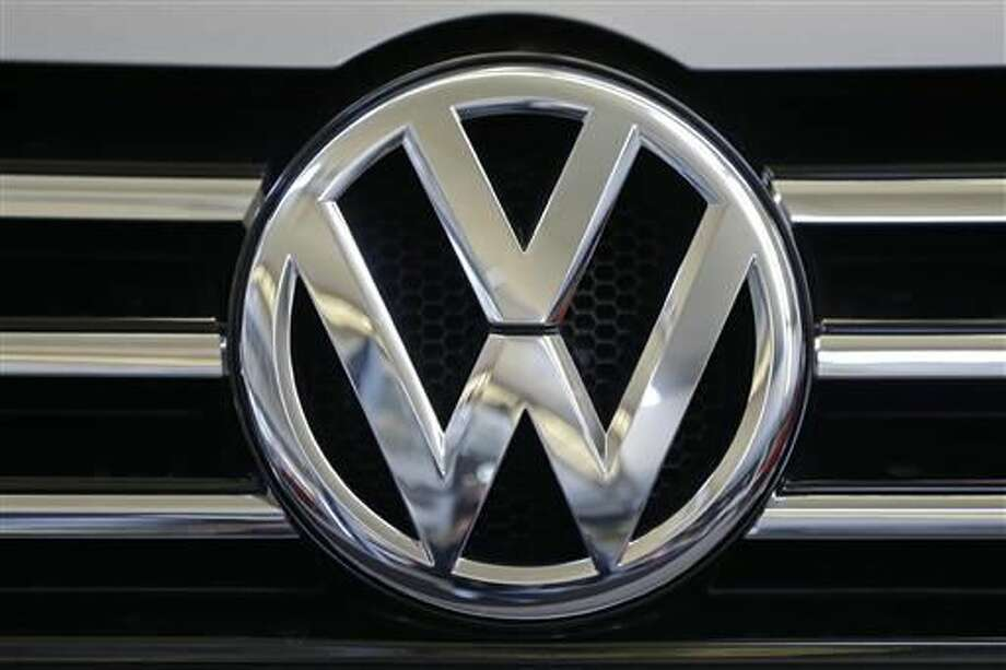 In this Feb. 14, 2013, file photo, the Volkswagen logo is seen on the grill of a Volkswagen on display in Pittsburgh. Volkswagen would repair or buy back polluting vehicles and pay each owner as much as $10,000 under a $14.7 billion deal the car maker has reached to settle lawsuits stemming from its emissions cheating scandal, a person briefed on the settlement talks said Monday, June 27, 2016. (AP Photo/Gene J. Puskar, File)