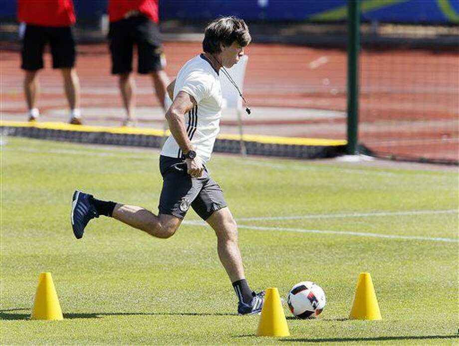 Coach Joachim Loew kicks the ball during the last training session of the German national football team at their base camp in Evian-Les-Bains, France, Wednesday, July 6, 2016. Germany will face France in a Euro 2016 semifinal soccer match in Marseille on Thursday, July 7, 2016 (AP Photo/Michael Probst) Photo: Michael Probst