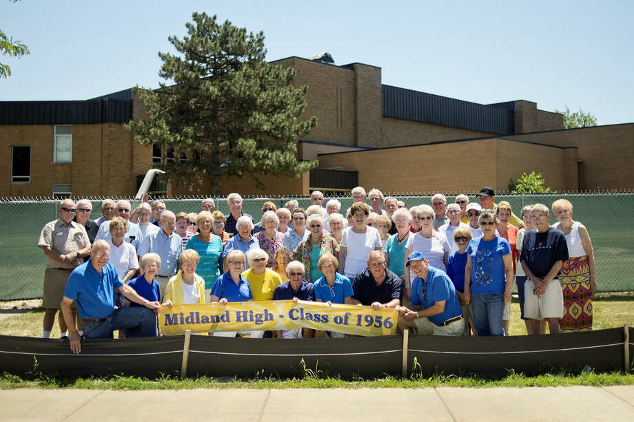 Members of the Midland High School class of 1956 pose for a picture outside of Central Middle School on Saturday. Photo: Nick King/Midland Daily News