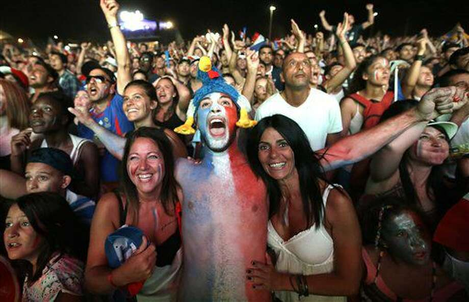 French supporters celebrate France's victory in the Marseille fan zone after the Euro 2016 semifinal soccer match between Germany and France,Thursday, July 7, 2016 in Marseille, southern France. France won 2-0. (AP Photo/Claude Paris) Photo: Claude Paris