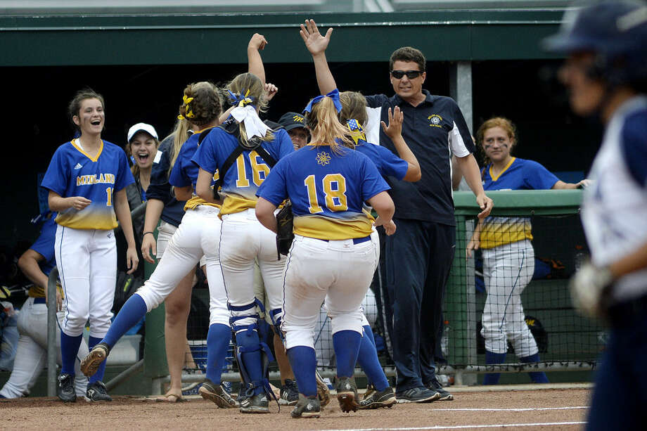 Midland High coach Robin Allen, right, led the Chemic softball program to its first final four appearance in 28 years. The Chemics lost in the state semifinals to Macomb Dakota, 4-2. Photo: Nick King | Midland Daily News