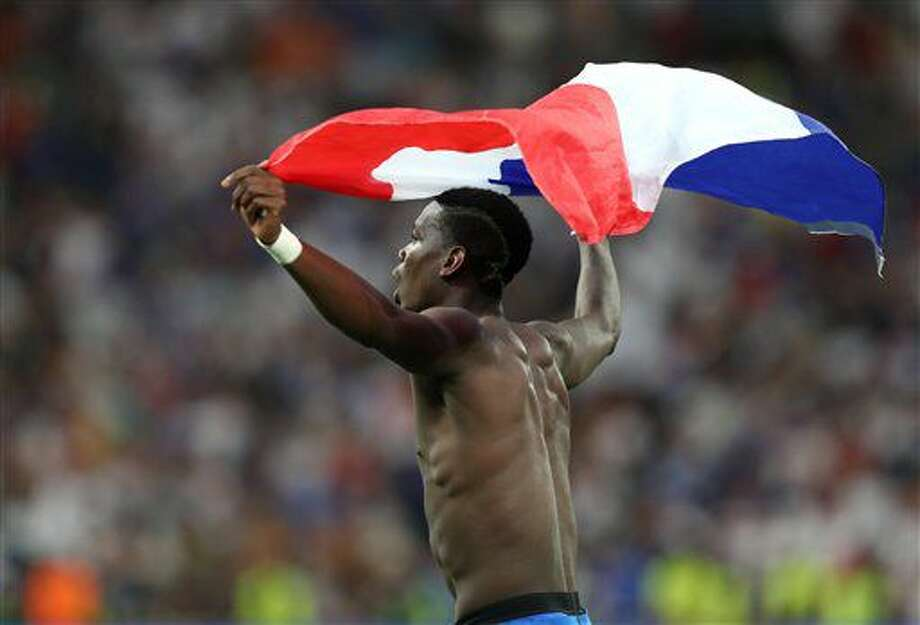 France's Paul Pogba celebrates holding the French flag after the Euro 2016 semifinal soccer match between Germany and France, at the Velodrome stadium in Marseille, France, Thursday, July 7, 2016. (AP Photo/Thanassis Stavrakis) Photo: Thanassis Stavrakis