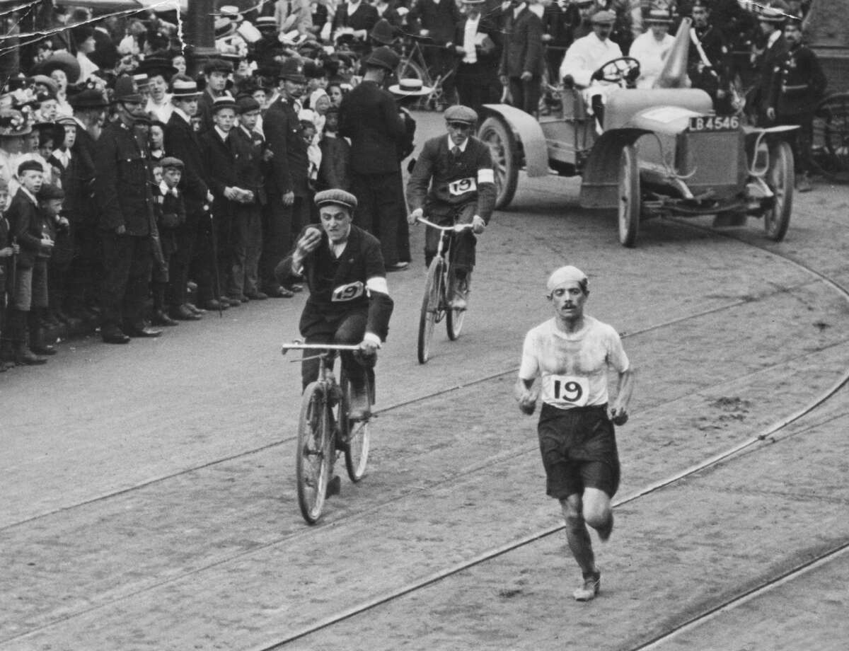 Italian athlete Dorando Pietri (1885-1942) approaches the White City Stadium at the end of the marathon, during the 1908 Summer Olympics in London, July 24, 1908. Despite being the first to the finish line, he was disqualified for having been physically supported at the end of the race.