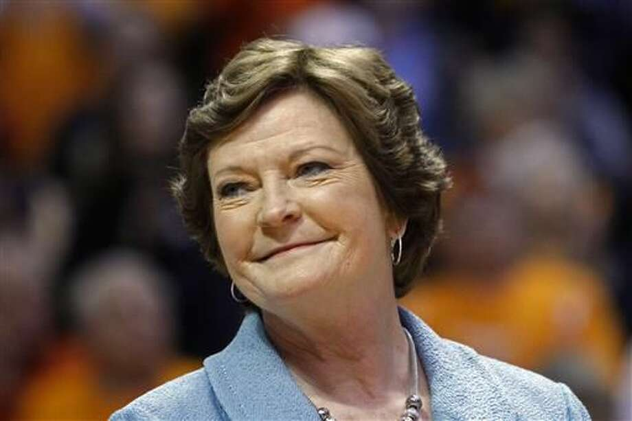 FILE - In this Jan. 28, 2013, file photo, former Tennessee women's basketball coach Pat Summitt smiles as a banner is raised in her honor before the team's NCAA college basketball game against Notre Dame in Knoxville, Tenn. Amid reports of Summitt's failing health as her Alzheimer's disease progresses, her family issued a statement Sunday, June 26, 2016, asking for prayers and saying that the former Tennessee women's basketball coach is surrounded by the people who mean the most to her. (AP Photo/Wade Payne, File)