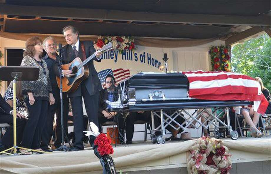Larry Sparks, right, Judy Marshall and Dan Marshall sing a Ralph Stanley song during the memorial service for Dr. Ralph Stanley on Tuesday, June 28, 2016, in McClure, Va. Sparks was a past member of the Clinch Mountain Boys which included Stanley. (Earl Neikirk/Bristol Herald Courier via AP) Photo: Earl Neikirk