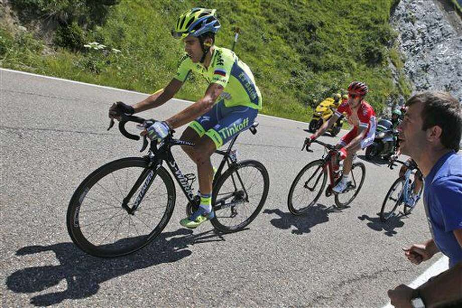 Spain's Alberto Contador, left, strains as he rides in the back of the pack with France's Nicolas Edet, right, during the ninth stage of the Tour de France cycling race over 184.5 kilometers (114.3 miles) with start in Vielha Val d'Aran, Spain, and finish in Andorra Arcalis, Andorra, Sunday, July 10, 2016. (AP Photo/Christophe Ena) Photo: Christophe Ena