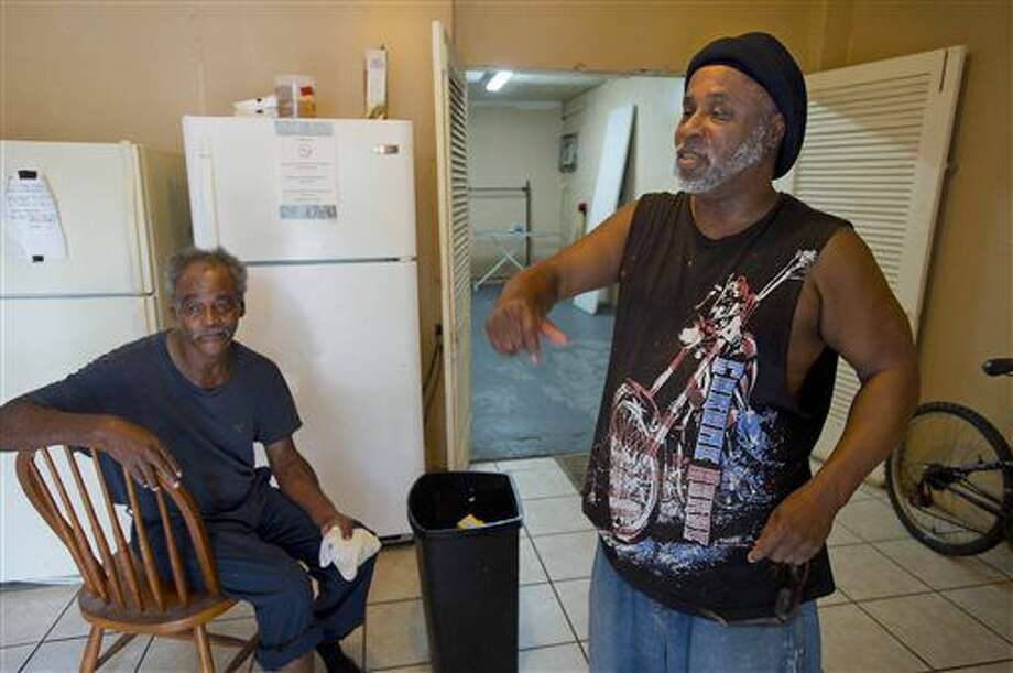 David Solomon, 60, left, and Calvin Wilson, 56, right, say they lived with Alton Sterling at the Living Waters Outreach Ministry Drop-In Center, and don't believe he carried a gun, on Tuesday, July 5, 2016, in Baton Rouge. Sterling was fatally shot during an altercation with Baton Rouge Police in the early morning hours of Tuesday, outside a Baton Rouge convenience store. (Travis Spradling/The Advocate via AP) Photo: Travis Spradling
