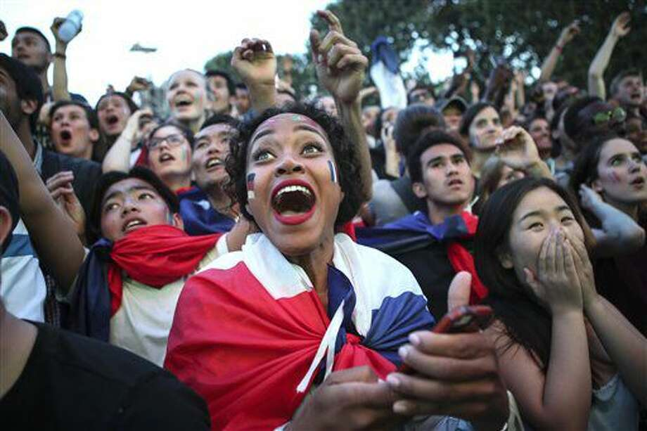 A French supporter watches the Euro 2016 semifinal soccer match between Germany and France,Thursday, July 7, 2016 in the Paris fan zone. (AP Photo/Kamil Zihnioglu) Photo: Kamil Zihnioglu