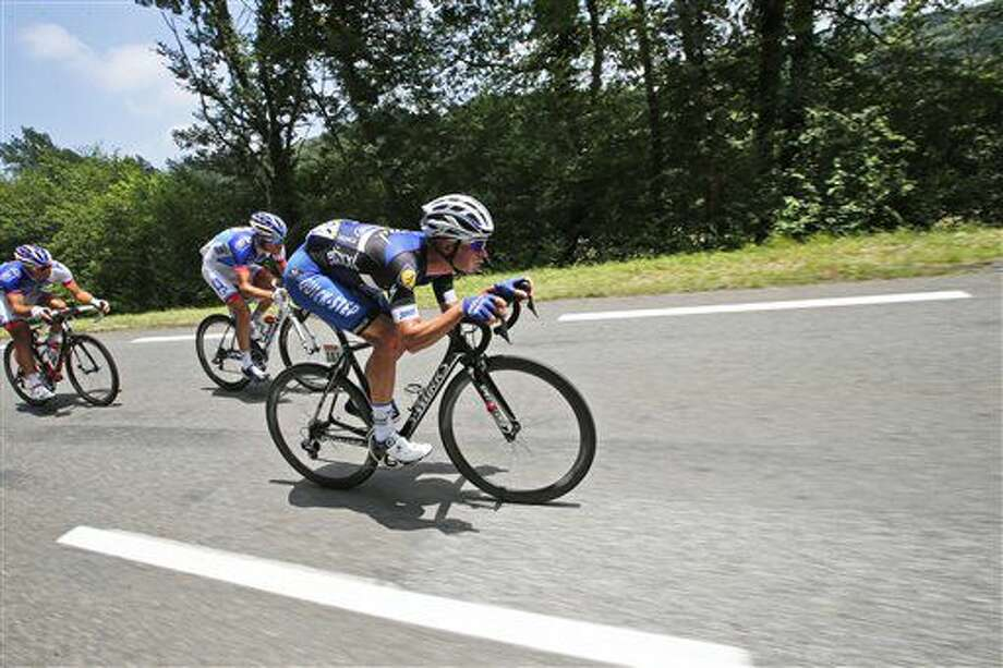 Belgium's Iljo Keisse, front is followed by France's Thibaut Pinot as they speed downhill during the seventh stage of the Tour de France cycling race over 162.5 kilometers (100.7 miles) with start in L'Isle-Jourdain and finish in Lac de Payolle, France, Friday, July 8, 2016. (AP Photo/Christophe Ena) Photo: Christophe Ena