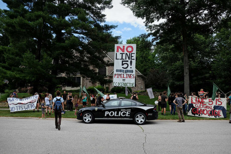 Demonstrators can be scene at the home of Attorney General Bill Schuette earlier this week. Photo: Photo Provided