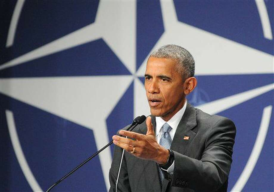 United States President Barack Obama gestures during a press conference ending the second day of the NATO Summit, in Warsaw, Poland, Saturday, July 9, 2016. U.S. President Barack Obama and other NATO leaders have begun the second day of a summit meeting in Warsaw that's expected to lead to decisions about Afghanistan, the central Mediterranean and Iraq. (AP Photo/Alik Keplicz) Photo: Alik Keplicz