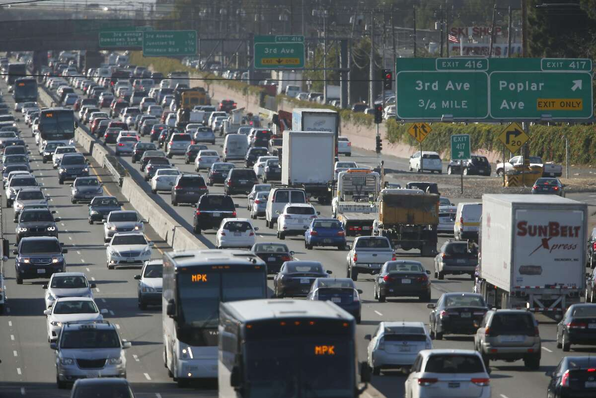 Morning commute traffic slows to a crawl in both directions of Highway 101 near the Peninsula Avenue overpass in San Mateo, Calif. on Wednesday, July 13, 2016. Regional transit officials have gathered the necessary funding to begin work on a express lane project on the Bayshore Freeway through San Mateo County.