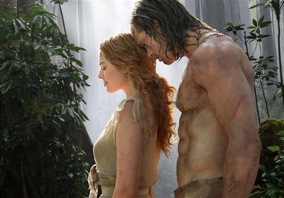 """This image released by Warner Bros. Entertainment shows Margot Robbie, left, and Alexander Skarsgard in a scene from """"The Legend of Tarzan."""" (Jonathan Olley/Warner Bros. Entertainment via AP) Photo: Jonathan Olley"""