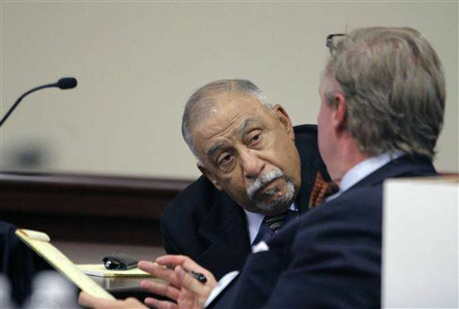 Former state Sen. Phil Griego, left, speaks to his attorney, Tom Clark, during his preliminary hearing at district court on Thursday, July 7, 2016 in Albuquerque, N.M. Witnesses called to testify Tuesday in a fraud case against former state Sen. Phil Griego told prosecutors they were left guessing about the lawmaker's involvement in the sale of a state-owned building in downtown Santa Fe that would later earn Griego a $51,000 commission. (Luis Sanchez Saturno/Santa Fe New Mexican via AP) Photo: Luis Sanchez Saturno