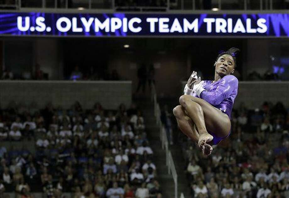 Simone Biles competes on the uneven bars during the women's U.S. Olympic gymnastics trials in San Jose, Calif., Friday, July 8, 2016. (AP Photo/Gregory Bull) Photo: Gregory Bull