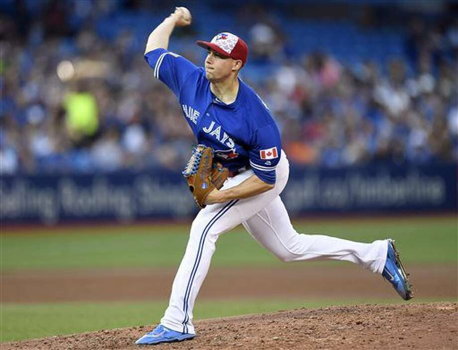 Toronto Blue Jays' Aaron Sanchez works against the Kansas City Royals during the seventh inning of a baseball game in Toronto, Monday, July 4, 2016. (Frank Gunn/The Canadian Press via AP) Photo: Frank Gunn
