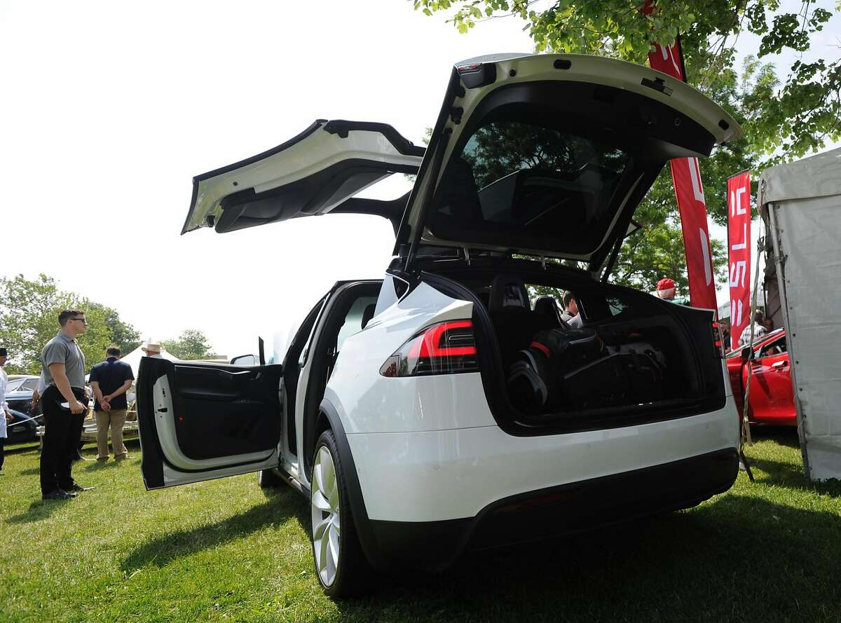 """A Tesla Model X, retailing for $80,000 was part of the Greenwich Concours d'Elegance at Roger Sherman Baldwin Park in Greenwich, Conn., Saturday, June 4, 2016. The show, considered by many to be one of the top ranked shows of its kind in the country, features vintage automobiles, vintage motorcycles, sports cars, electric cars, brand-new luxury models and various types of vehicles, is celebrating two decades of operation in Greenwich. Retired Brunswick School teacher Ted Stolar who said he loves cars and also said he has been coming to the show for ten years, called it a """"religious experience."""" Sunday hours for the show are 10 a.m. to 5 p.m. One day tickets are $40 at the gate. Children under 12 are free with an adult. Parking for the show is located across the street from Roger Sherman Badlwin Park."""