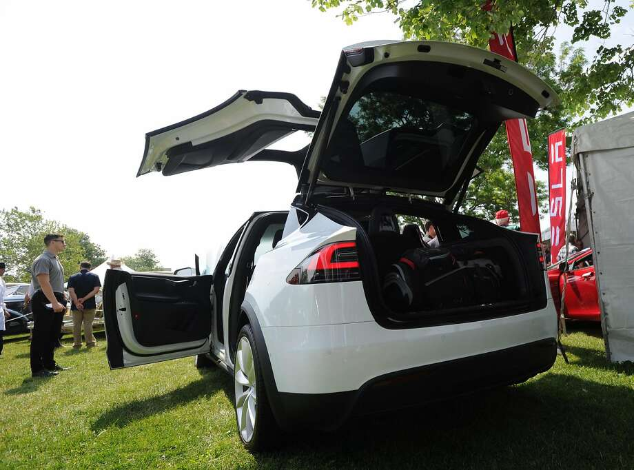 The Tesla Model X features distinctive falcon-wing doors. The new model will start at $74,000. Photo: Bob Luckey Jr., Hearst Connecticut Media