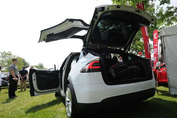 "A Tesla Model X, retailing for $80,000 was part of the Greenwich Concours d'Elegance at Roger Sherman Baldwin Park in Greenwich, Conn., Saturday, June 4, 2016. The show, considered by many to be one of the top ranked shows of its kind in the country, features vintage automobiles, vintage motorcycles, sports cars, electric cars, brand-new luxury models and various types of vehicles, is celebrating two decades of operation in Greenwich. Retired Brunswick School teacher Ted Stolar who said he loves cars and also said he has been coming to the show for ten years, called it a ""religious experience.""  Sunday hours for the show are 10 a.m. to 5 p.m. One day tickets are $40 at the gate. Children under 12 are free with an adult. Parking for the show is located across the street from Roger Sherman Badlwin Park."