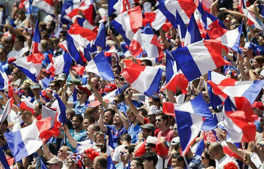 France supporters wave flags on the stands before the Euro 2016 round of 16 soccer match between France and Ireland, at the Grand Stade in Decines-Charpieu, near Lyon, France, Sunday, June 26, 2016. (AP Photo/Pavel Golovkin) Photo: Pavel Golovkin