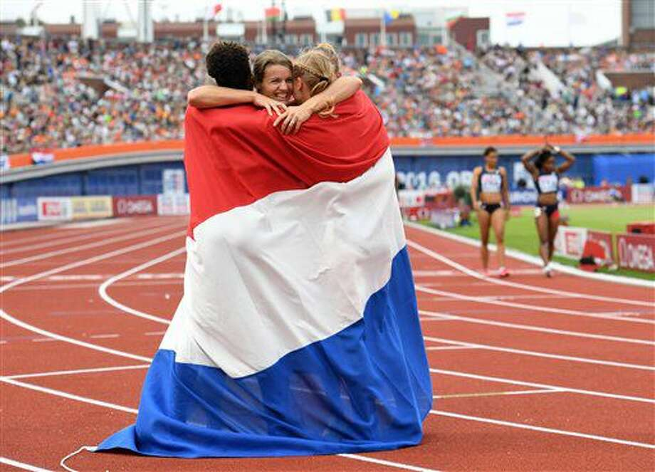 Dafne Schippers of the Netherlands, centre, celebrates with her teammates after they won the gold medal in the final of the women's 4x100m relay during the European Athletics Championships in Amsterdam, the Netherlands, Sunday, July 10, 2016. (AP Photo/Geert Vanden Wijngaert) Photo: Geert Vanden Wijngaert