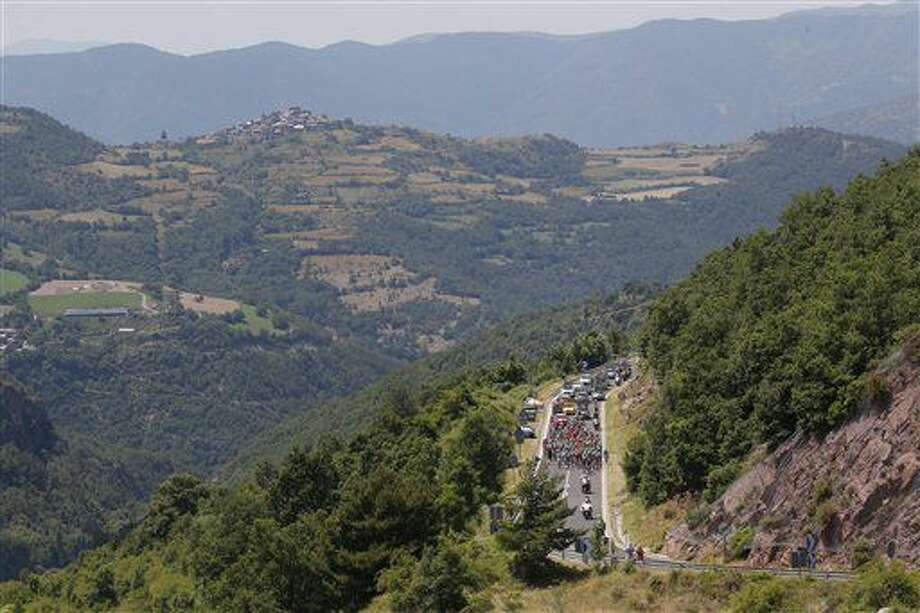 The pack climbs Canto pass, Spain, during the ninth stage of the Tour de France cycling race over 184.5 kilometers (114.3 miles) with start in Vielha Val d'Aran, Spain, and finish in Andorra Arcalis, Andorra, Sunday, July 10, 2016. (AP Photo/Christophe Ena) Photo: Christophe Ena