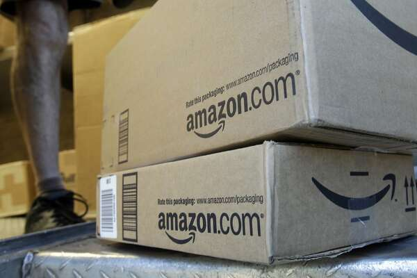 """FILE - In this June 30, 2011 file photo, a United Parcel Service driver delivers packages from Amazon.com in Palo Alto, Calif. Amazon is offering deals July 12, 2016, for the second edition of its annual """"Prime Day"""" promotion. (AP Photo/Paul Sakuma, File)"""